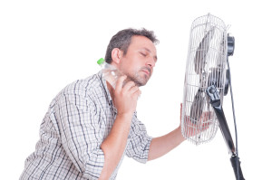 Man cooling down in front of blowing fan